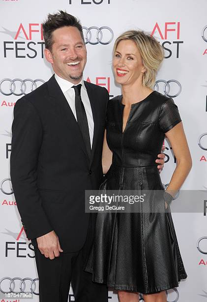 Director Scott Cooper and wife Jocelyne Cooper arrive at the AFI FEST 2013 premiere of Out Of The Furnace at TCL Chinese Theatre on November 9 2013...