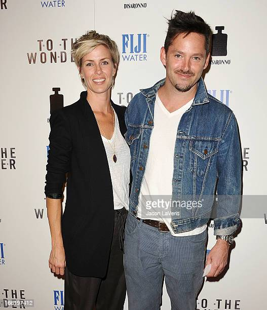 Director Scott Cooper and wife Jocelyne Cooper attend the premiere of To The Wonder at Pacific Design Center on April 9 2013 in West Hollywood...