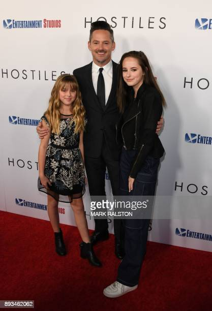 Director Scott Cooper with his daughters Stella and Eva arrive for the premiere of 'Hostiles' in Beverly Hills California on December 14 2017 / AFP...