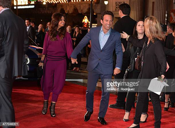"""Director Scott Waugh and guest arrive for the premiere of DreamWorks Pictures' """"Need For Speed"""" at TCL Chinese Theatre on March 6, 2014 in Hollywood,..."""