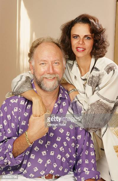 TV director screenwriter and producer Donald Bellisario poses with his wife Deborah Pratt during a 1990 Los Angeles California photo portrait session