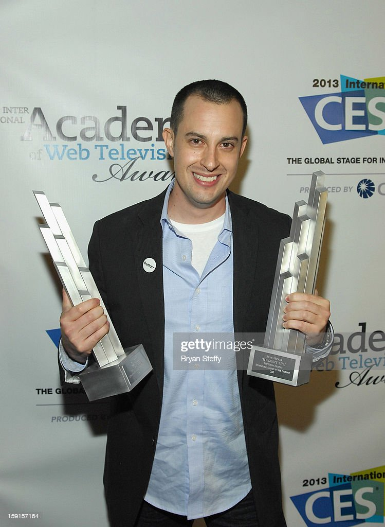 Director Sean Becker poses with the IAWTV awards for Best Comedy Directing and Best Non Fiction Directing at the IAWTV Awards at the CES 2013 Show at the Palazzo Theater at the Palazzo Resort Hotel/Casino on January 8, 2013 in Las Vegas, Nevada.