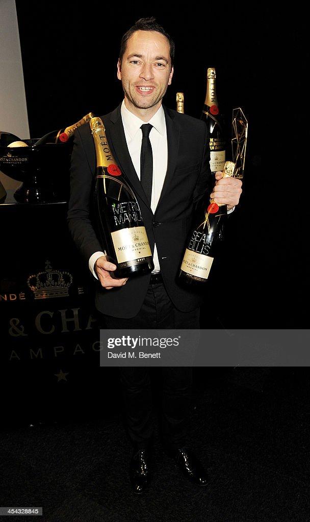 Director Sean Ellis, winner of the Best British Independent Film Award for 'Metro Manila', poses backstage at the Moet British Independent Film Awards 2013 at Old Billingsgate Market on December 8, 2013 in London, England.