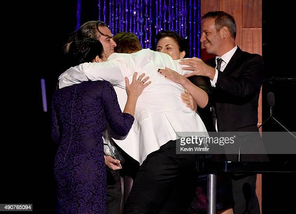 Director Shaun Monson accepts the River Phoenix Award from actor Joaquin Phoenix Liberty Phoenix Arlyn Phoenix and Jeffrey Weisberg onstage at PETA's...