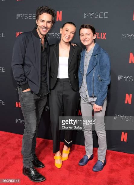 Director Shawn Levy Millie Bobby Brown and Noah Schnapp attend The 'Stranger Things 2' Panel At Netflix FYSEE on May 19 2018 in Los Angeles California