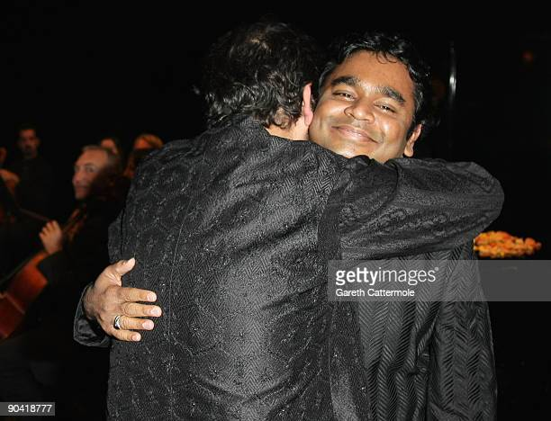 Director Shekhar Kapur embraces compsoer AR Rahman as they attend the Swarovski hosted 'The Passage' Party during the 66th Venice Film Festival on...