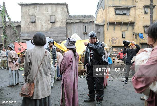 Director Shinji Higuchi gives direction during the filming of 'Attack on Titan' on June 9 2014 in Takahagi Japan