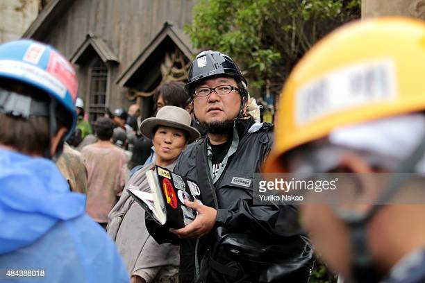 Director Shinji Higuchi speaks with his crew during the filming of 'Attack on Titan' on June 9 2014 in Takahagi Japan