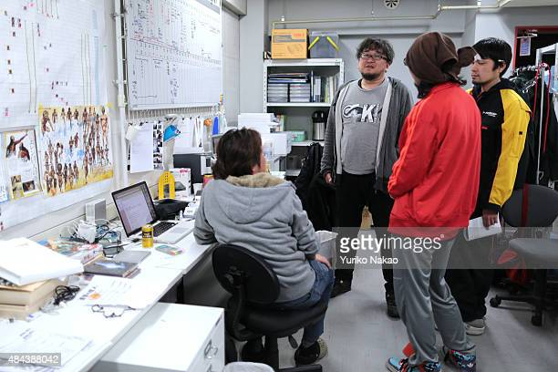 Director Shinji Higuchi speaks with his crew for 'Attack on Titan' at a working room in Toho Studios on April 4 2014 in Tokyo Japan