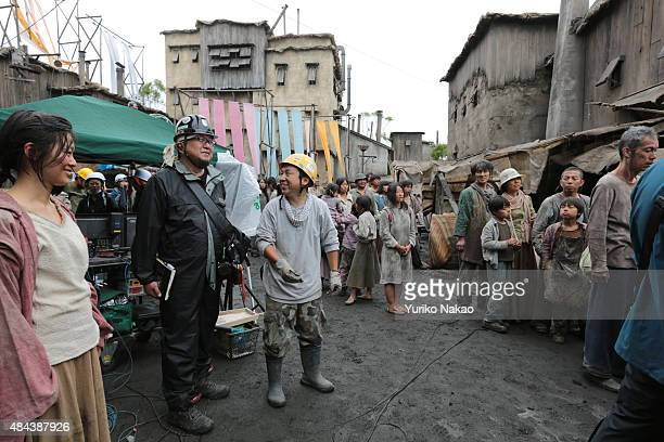 Director Shinji Higuchi talks with his film crew on the set during the filming of 'Attack on Titan' on June 9 2014 in Takahagi Japan