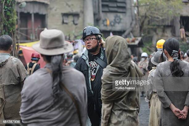 Director Shinji Higuchi walks through the set during the filming of 'Attack on Titan' on June 9 2014 in Takahagi Japan