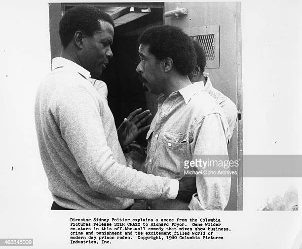 Director Sidney Poitier explains to actor Richard Pryor a scene from the movie Stir Crazywhich was releaseed on December 12 1980