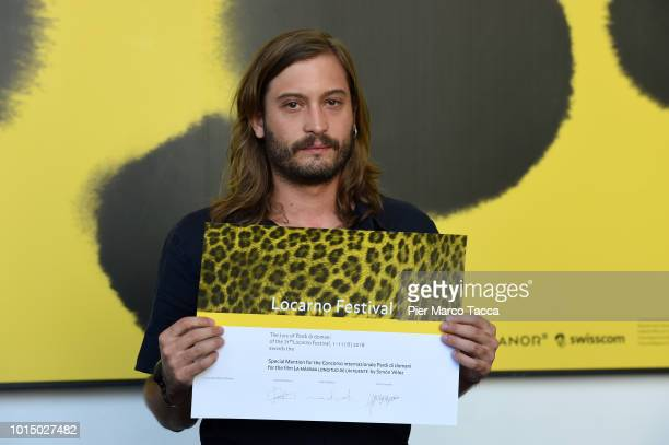 Director Simon Velez poses with a Special Mention for Pardi di Domani Competition at the Palmares photocall during the 71st Locarno Film Festival on...