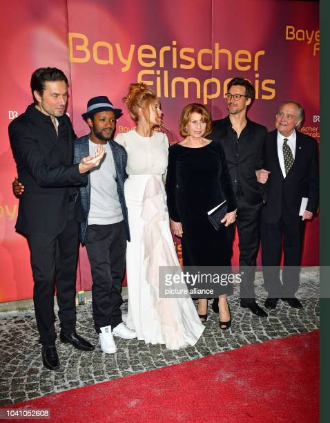Director Simon Verhoeven actors Eric Kabongo Palina Rojinski Senta Berger Florian David Fitz and director Michael Verhoeven at the Bavarian Film...