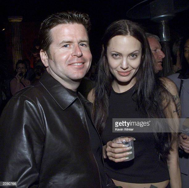 Director Simon West and Angelina Jolie at the afterparty for the premiere of the film 'Lara Croft Tomb Raider' in Los Angeles Ca 6/11/01 Photo by...