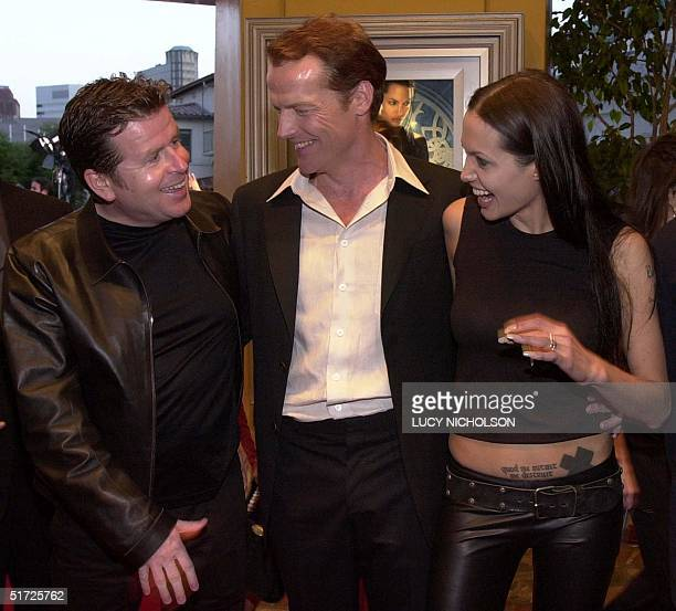 US director Simon West meets cast members Iain Glen and Angelina Jolie at the premiere of their new film 'Lara Croft Tomb Raider' in Los Angeles 11...