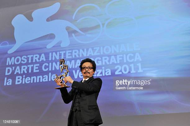 Director Sion Sono of Himizu accepts the Marcello Mastroianni Award for Best Young Actor or Actress on behalf of Shota Sometani and Fumi Nikaido...