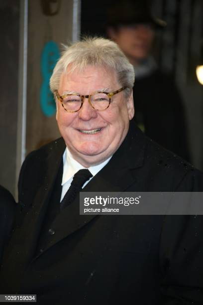 Director Sir Alan Parker arrives at the EE British Academy Film Awards at The Royal Opera House in London England on 10 February 2013 Photo Hubert...