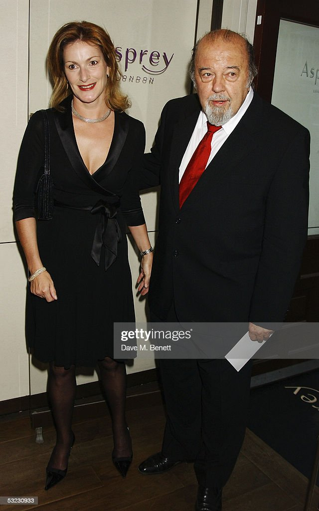 Director Sir Peter Hall and Nicola Frei attend Renee Fleming's private Asprey dinner party at Asprey's flagship store in Bond Street July 12, 2005 in London, England.