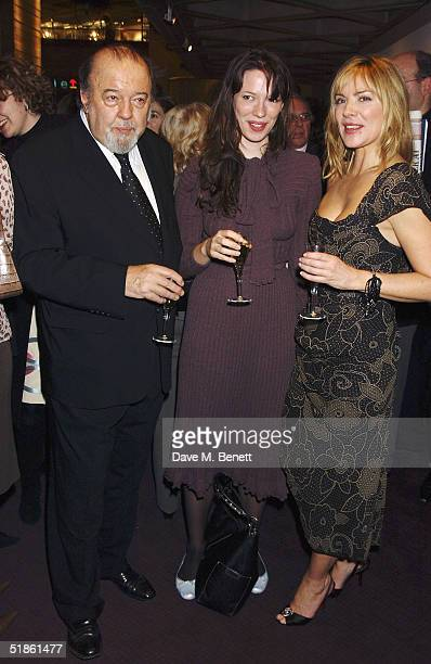Director Sir Peter Hall with guest and actress Kim Cattrall and film director Richard Eyre attend the Evening Standard Theatre Awards at the National...