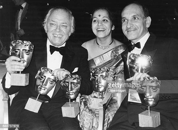Director Sir Richard Attenborough with actors Rohini Hattangadi and Ben Kingsley holding the many BAFTA awards their film 'Gandhi' won at the...