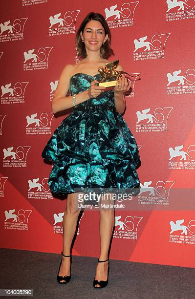 Director Sofia Coppola poses with the Golden Lion Award For Best Film 'Somewhere' at the Award Winners photocall during the 67th Venice Film Festival...