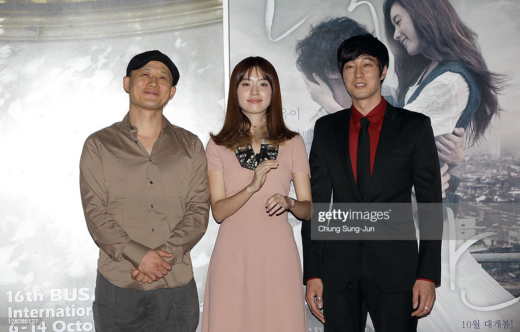 Director Song Il-Gon,actress HAN Hyo-Joo and actor So Ji-Sub attend a photocall for 'Always', the opening film of the 16th Busan International Film Festival (BIFF) during the press conference at the Busan Cinema Center on October 6, 2011 in Busan, South Korea. The biggest film festival in Asia showcases 307 films from 70 countries and runs from October 6-14.