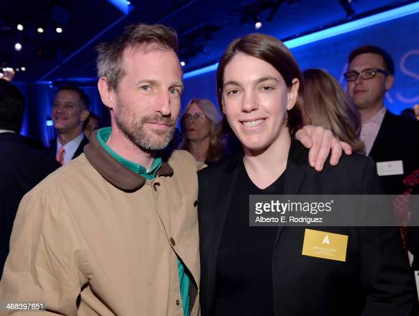 Director Spike Jonze and producer Megan Ellison attend the 86th Academy Awards nominee luncheon at The Beverly Hilton Hotel on February 10 2014 in...