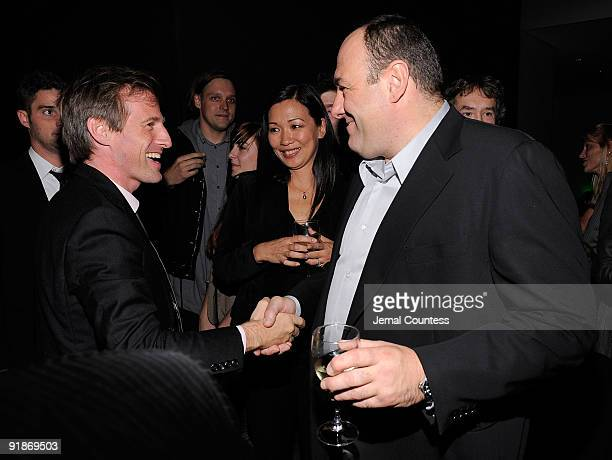 Director Spike Jonze greets actor James Gandolfini and wife Deborah Lin at the after party for the Where The Wild Things Are premiere at The Museum...