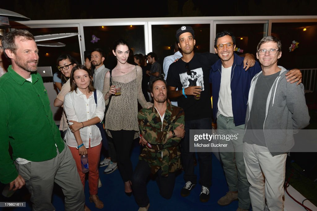 Director Spike Jonze, Natalie Farrey, guest, DV Devincent, DJ Ako, Geoff McFetridge and Eric Zumbrunne attend Warby Parker's store opening in The Standard, Hollywood on August 15, 2013 in Los Angeles, California.