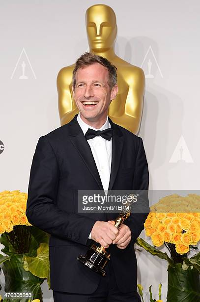 Director Spike Jonze winner of Best Writing Screenplay Written Directly for the Screen poses in the press room during the Oscars at Loews Hollywood...