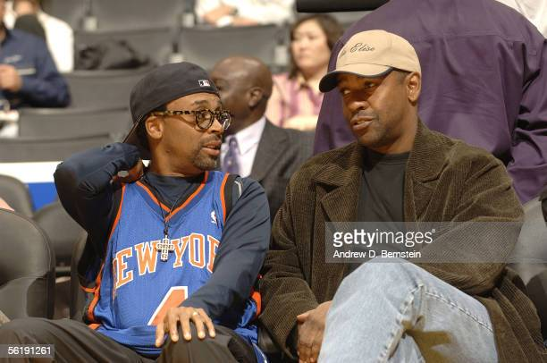 Director Spike Lee and actor Denzel Washington sit courtside as the Los Angeles Lakers play against the New York Knicks on November 16 2005 at...