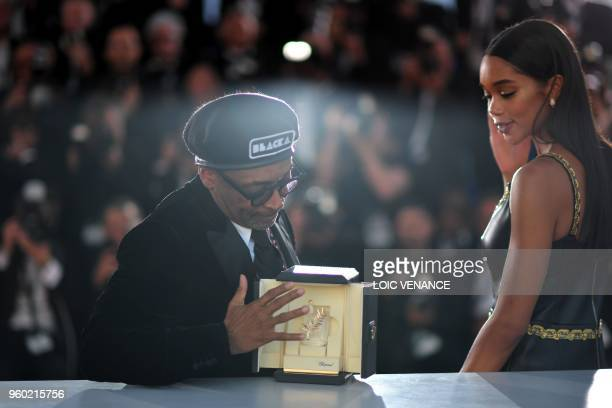 US director Spike Lee and US actress Laura Harrier pose with the trophy on May 19 2018 during a photocall after Lee won the Grand Prix for the film...