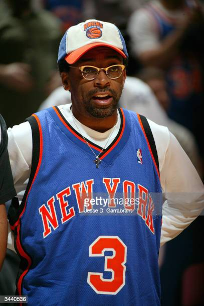 Director Spike Lee cheers on the New York Knicks as they take on the New Jersey Nets in game one of round one in the NBA Playoffs on April 17 2004 at...