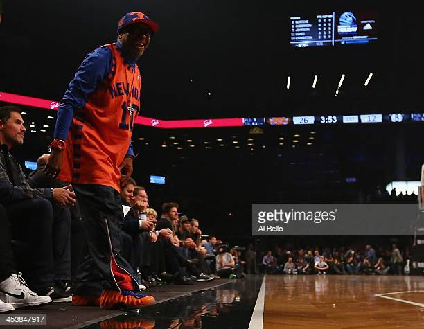 Director Spike Lee cheers on the New York Knicks during their game against the Brooklyn Nets at the Barclays Center on December 5 2013 in the...