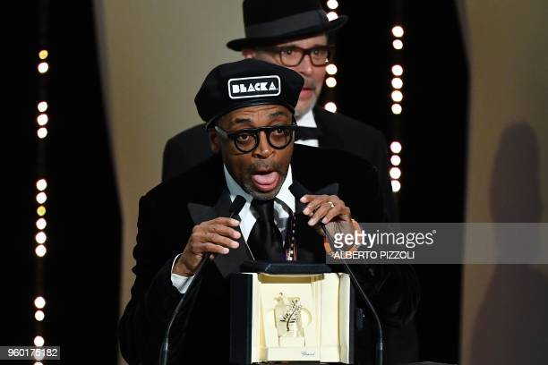 US director Spike Lee delivers a speech on stage on May 19 2018 after he was awarded with the Grand Prix for the film 'BlacKkKlansman' during the...