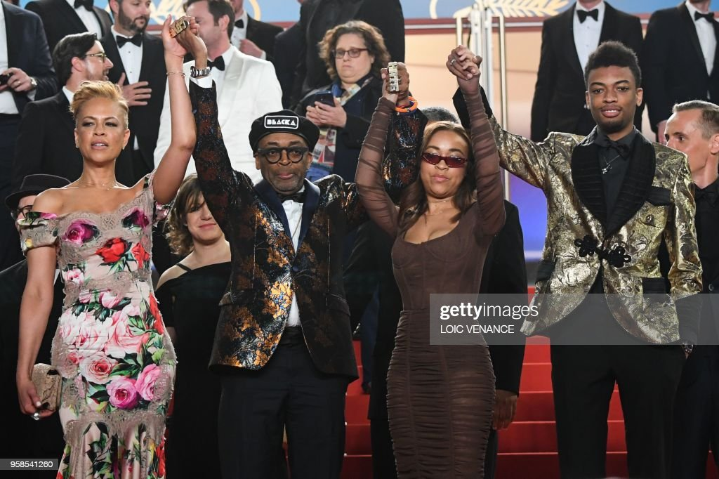 US director Spike Lee (2ndL), his wife Tonya Lewis Lee (L), their children Satchel Lee (2ndR) and Jackson Lee pose on May 14, 2018 while leaving following the screening of the film 'BlacKkKlansman' at the 71st edition of the Cannes Film Festival in Cannes, southern France.