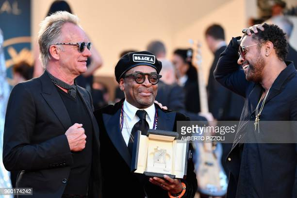 US director Spike Lee holds the Grand Prix award as he poses on May 19 2018 with British musician and singer Sting and Jamaican singer Shaggy after...