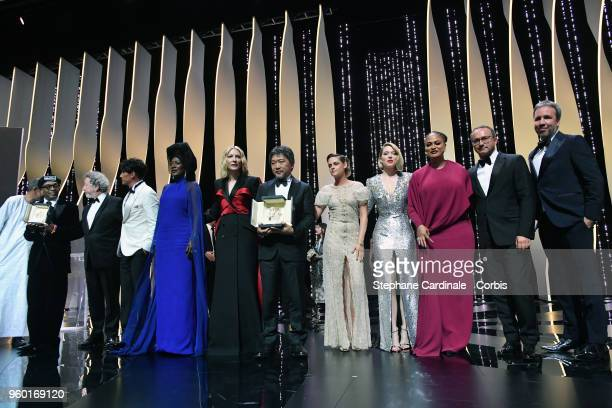 Director Spike Lee holds the Grand Prix award for 'BlacKkKlansman' as jury members Robert Guediguian Chang Chen Khadja Nin Jury president Cate...