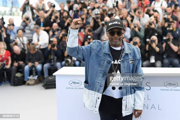 Director Spike Lee holds up a fist as he attends the photocall for BlacKkKlansman during the 71st annual Cannes Film Festival at Palais des Festivals...