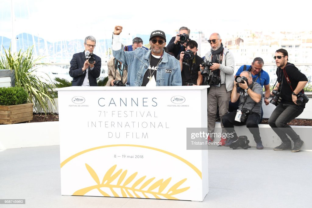 Director Spike Lee holds up a fist as he attends the photocall for 'BlacKkKlansman' during the 71st annual Cannes Film Festival at Palais des Festivals on May 15, 2018 in Cannes, France.
