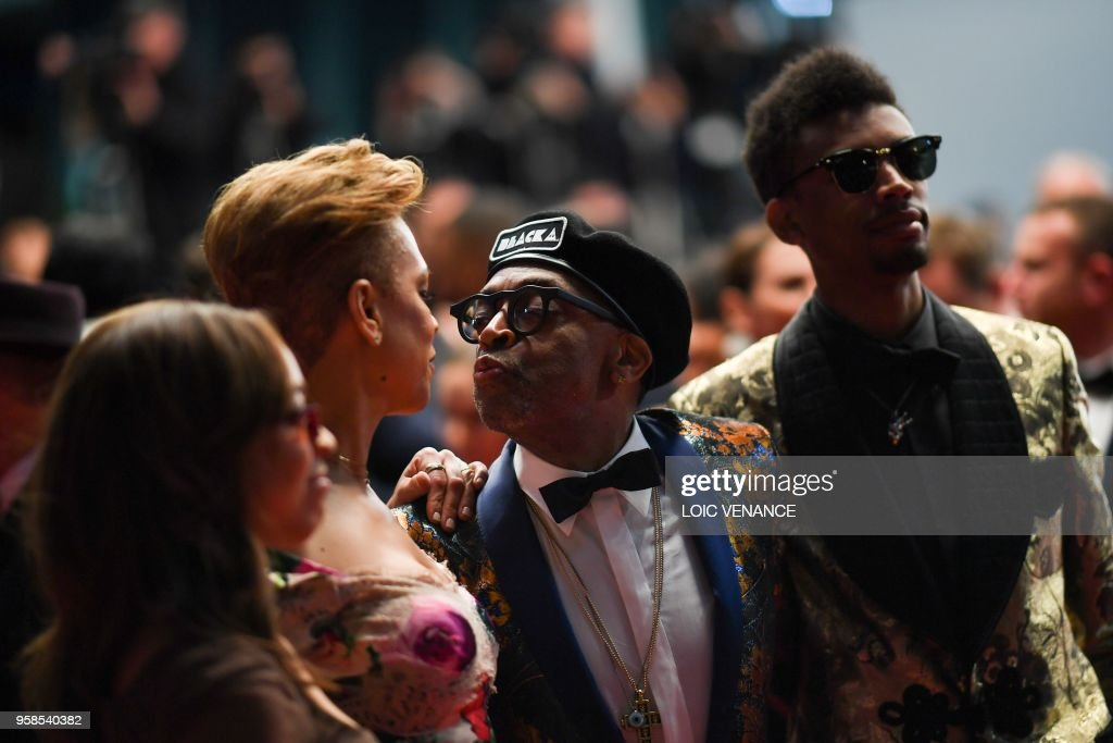 US director Spike Lee (2ndR) kisses his wife Tonya Lewis Lee (2ndL), as their children Satchel Lee (L) and Jackson Lee look on, on May 14, 2018 while leaving following the screening of the film 'BlacKkKlansman' at the 71st edition of the Cannes Film Festival in Cannes, southern France.