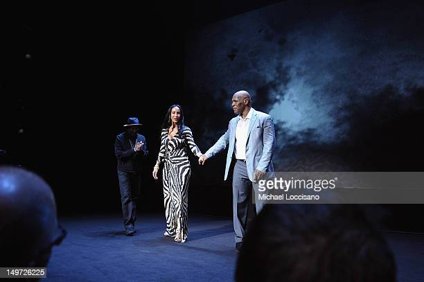 Director Spike Lee Lakiha Spicer and husband Mike Tyson take part in a curtain call during the Mike Tyson Undisputed Truth Broadway Opening Night at...
