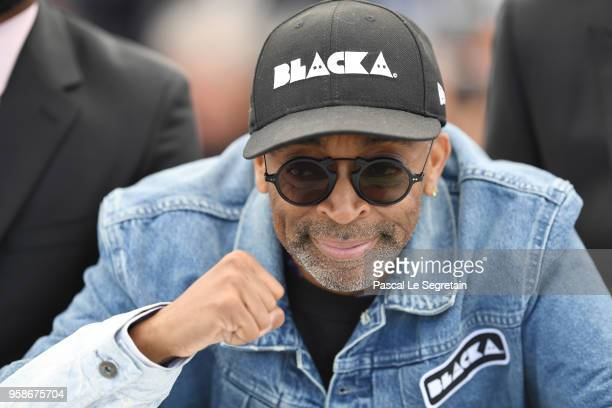 Director Spike Lee makes a fist as he attends the photocall for BlacKkKlansman during the 71st annual Cannes Film Festival at Palais des Festivals on...