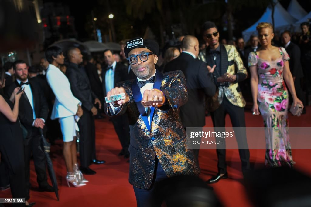 US director Spike Lee poses as he leaves along with his wife Tonya Lewis Lee (R) and their son Jackson Lee (2ndR) on May 14, 2018 following the screening of the film 'BlacKkKlansman' at the 71st edition of the Cannes Film Festival in Cannes, southern France.