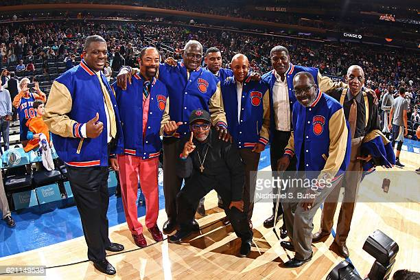 Director Spike Lee poses for a photo with New York Knicks legends before the game against the Memphis Grizzlies on October 29 2016 at Madison Square...