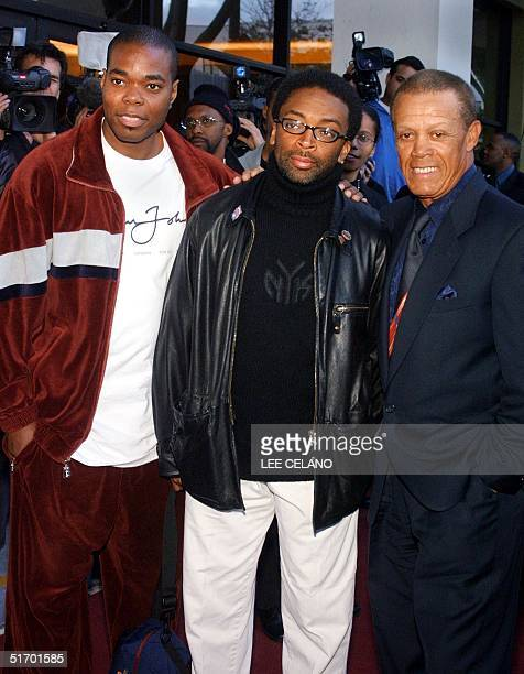 US director Spike Lee poses with actor US Gabriel Casseus and former US baseball star Maury Wills at the premiere of Lee's documentary feature Jim...