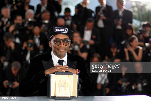 US director Spike Lee poses with his trophy on May 19 2018 during a photocall after he won the Grand Prix for the film BlacKkKlansman at the 71st...