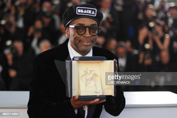 US director Spike Lee poses with his trophy on May 19 2018 during a photocall after he won the Grand Prix for the film 'BlacKkKlansman' at the 71st...
