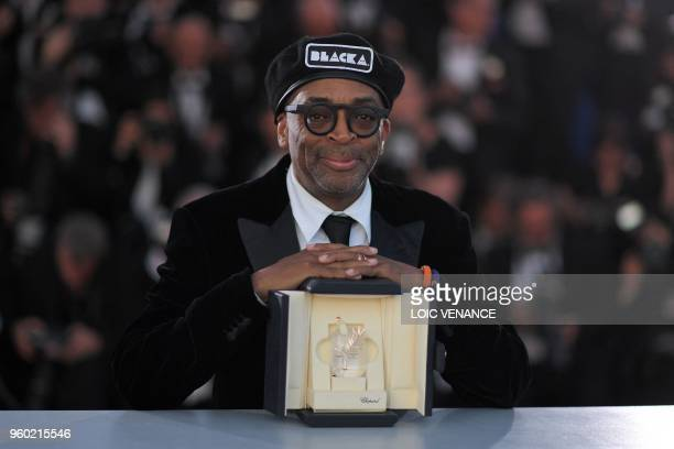 TOPSHOT US director Spike Lee poses with his trophy on May 19 2018 during a photocall after he won the Grand Prix for the film 'BlacKkKlansman' at...